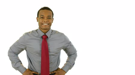 contentamento : An attractive young smiling African American businessman. Isolated on white making copy space easy. Stock Footage