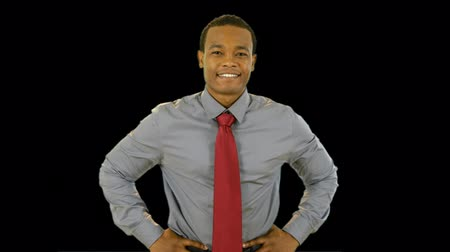 contentamento : An attractive young smiling African American businessman. With Alpha Channel for easy import of your own background. No keying out needed.