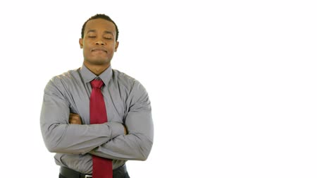 contentamento : An attractive young African American businessman with confident expression and body language. Isolated on white making copy space easy. Stock Footage