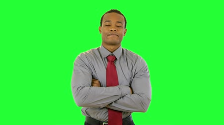 contentamento : An attractive young African American businessman with confident expression and body language. Green Screen. Easy to key out and add your own background. Stock Footage