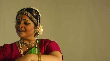 indian ethnicity : A lovely young woman storytelling with mudra or hand gestures traditional to classical Indian dance.