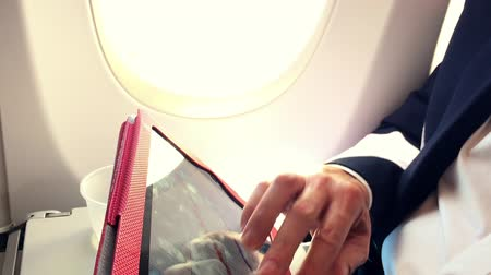 small businessman : businessman on a passenger plane working with his tablet pc Stock Footage