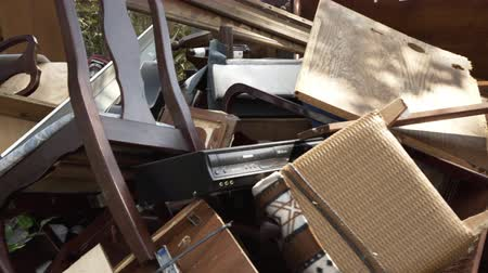 homeless : Antique furniture and other belongings placed placed outside for removal due to irreparable floodwater damage.