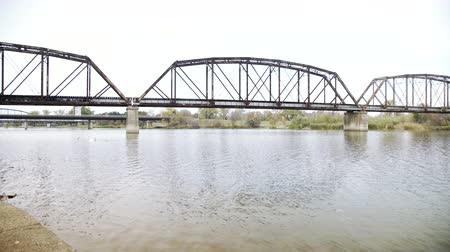 pan across brazos river showing old train bridge waco texas 4k