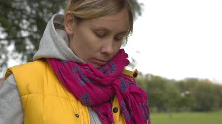 aluno : Closeup of  woman using tablet pc in the park