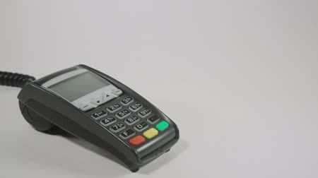 payment : Hand swiping generic credit card on an over counter POS terminal