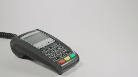 Hand swiping generic credit card on an over counter POS terminal