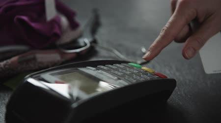 chip and pin : hand swiping credit card in store