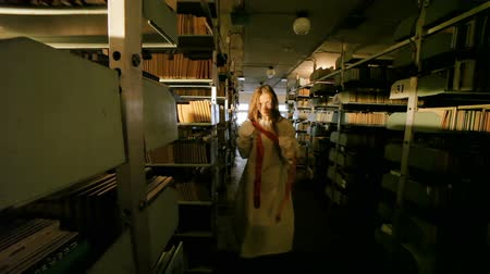 ужасный : Zombie woman in a dark book store, shes awful.
