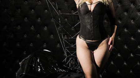 Woman in a corset in the style of BDSM. Wideo