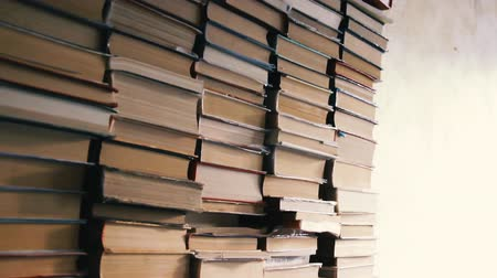 вертикально : Stacks of volumes in the room. Bookworm interior. Several vertically stacked packs of manuscripts. Abandoned bookstore apartment or book depository. Archive literature library. Science collection
