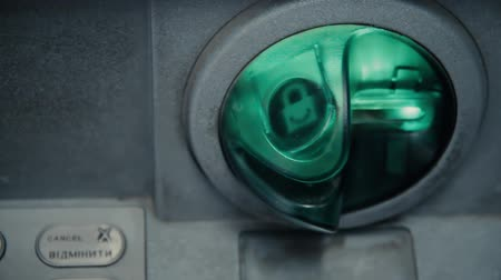 geri çekilme : Blinking grunge slot in ATM machine. Withdrawal cash. ATM machine is blinking and ready to accept credit card. Green plastic insert to protect bank from hacker to sniff valuable data with shimming
