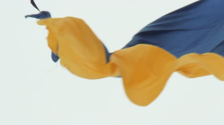 oy : The flag of Ukraine flutters in the wind on a high flagpole in Dnipro city. Shooting at close range. Real flag in windy afternoon. Independence symbol close up. Sky on background