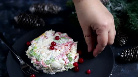 Festive salad with breadcrumbs, balyk, Beijing cabbage. Suitable for New Year .Christmas treat. Garnished with cranberries.