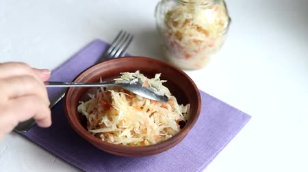 Fermented cabbage salad with red onion. Pour with vegetable oil. Healthy eating Vegetarian dish. Stok Video