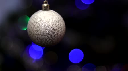 owsianka : Christmas tree decorated with toys and sparkles. Against the background of blue, trend 2020. Wideo