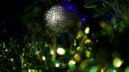 lindeboom : Christmas tree decorated with toys and sparkles. Against the background of blue, trend 2020. Stockvideo