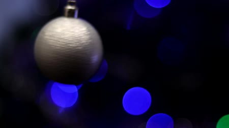 モヒート : Christmas tree decorated with toys and sparkles. Against the background of blue, trend 2020. 動画素材