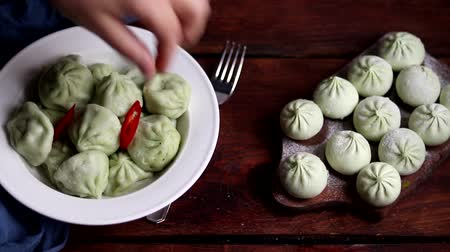 укроп : Boiled khinkali made of dough with spinach. Garnished with Red Chilli, Dill and Parsley.