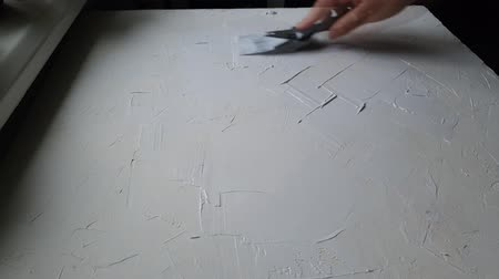 bezelye : Covering the background with putty for wood. Application of the top coat. Light color. Repair work Stok Video