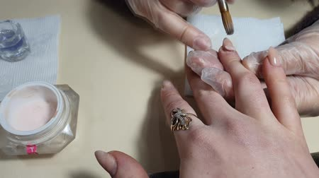 diyabet : The master does nail extension. Manicure. The old mother al is cut off and a new one is superimposed. Correction of nails. Hands close up. Stok Video