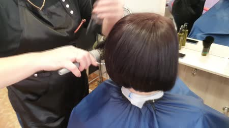 diyabet : The master is engaged in painting and tinting. Drying the client with dark, wet hair dryer. Hairstyle. Hair close up.