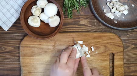 cuttlefish : Slicing ingredients for a rice dish with vegetables. Vegetarian dish. Mushrooms and carrots onions. Healthy diet. On a wooden background.