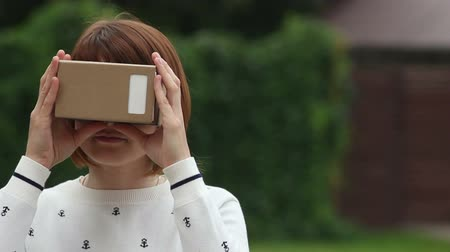 tektura : Young Woman in Virtual Reality Glasses cardboard. VR 360
