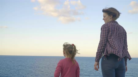 crete : Mother and daughter standing on top of a mountain and looking at the sea. Sunset . Greece. Crete. Stock Footage