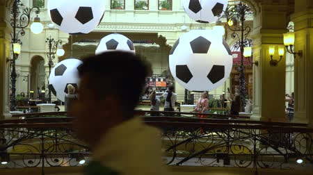 néző : Lot of soccer balls are floating in the fountain of the Moscow Central Universal Department Store as a World Cup 2018 decoration. July 1, 2018 in Moscow, Russia.
