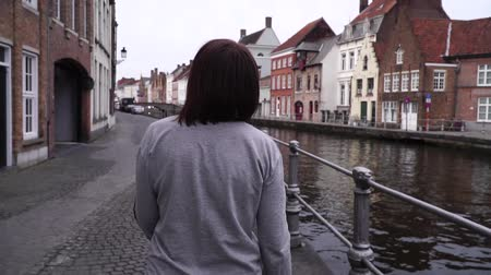 bruges : girl walks and looks at attractions in the city of Bruges Belgium. slow motion