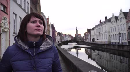 bruges : girl walks and looks at attractions in the city of Bruges Belgium Stock Footage