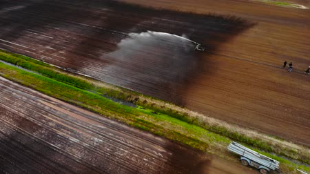 sow : Drone view of field irrigation