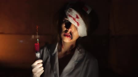 wicked : Woman in makeup of bloody nurse
