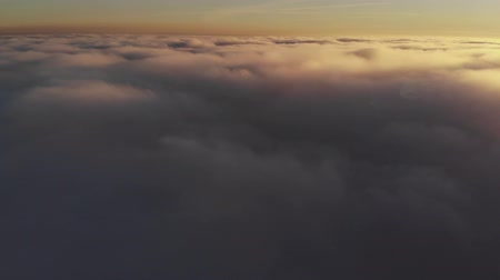 imaginário : aerial shot above thick clouds upper surface against horizon