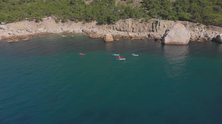 kano : Aerial shot group of kayakers paddling down on mountain river on kayaks on summer day