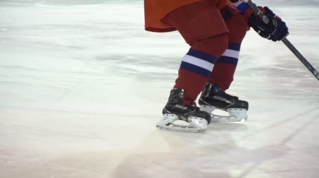 Ice hockey. The hockey player slide on icea in slow motion Stock mozgókép