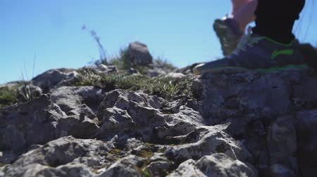 legs close up climbers climbing the mountains trail Stock mozgókép