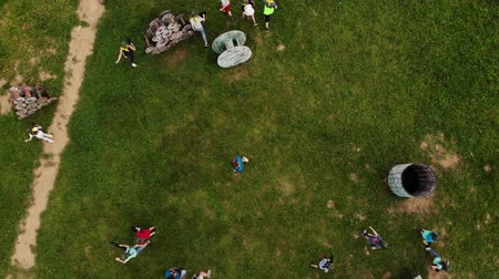 targeting : Team of players playing paintball on summer playground, aerial top view Stock Footage