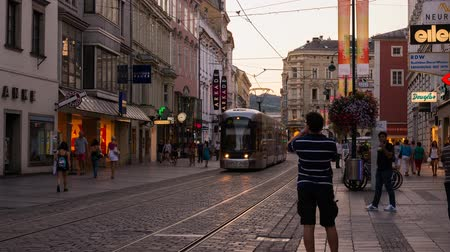 Linz, Austria - July 21, 2015: Linz Landstrasse Austria with people, shops, trams at night