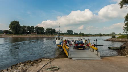 Bronkhorst, The Netherlands - September 9, 2015: Time lapse of the ferry at Bronkhorst on the river IJssel.
