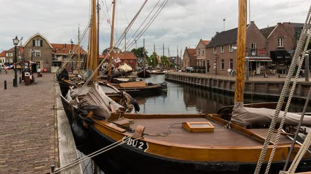 Spakenburg, The Netherlands - August 25, 2015: Time lapse of the harbor or spakenburg with old wooden sailing and fishing boats, The Netherlands. Wideo