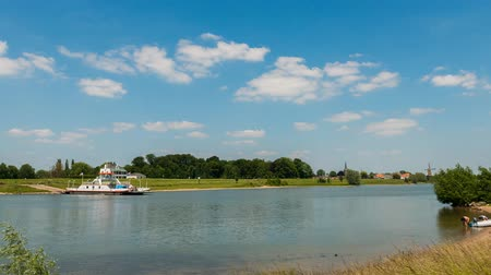Wijk bij Duurstede, The Netherlands - June 11, 2015: Time lapse of the ferry at Wijk bij Duurstede in the Dutch province of Utrecht on the river Lower Rhine. Wideo