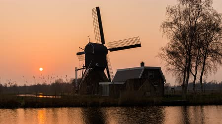 equinox : Exit Woerden, The Netherlands - March 19, 2015: Sunset with Westveense Mill in Woerden mill in the province of Utrecht.