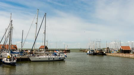 Hindeloopen, The Netherlands - May 21, 2015: Time lapse of the harbor or hindeloopen with sailboats in the Netherlands.