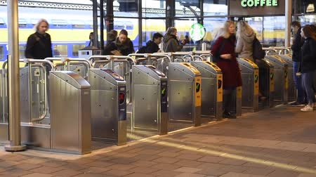 Nijmegen, Netherlands - November 7, 2017: Public transport gates at railway central station Nijmegen with travellers and trains at the platform. Wideo