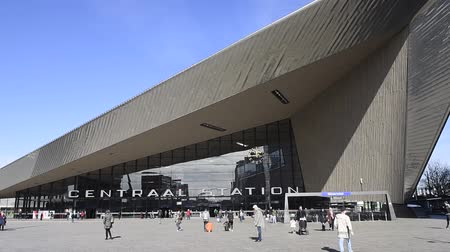 Rotterdam, The Netherlands - March 10, 2017: Modern railway station by architect MVSA in Rotterdam with square and travelers in the Netherlands.