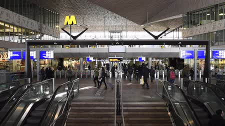 mozgólépcső : Rotterdam, The Netherlands - March 10, 2017: Interior of modern railway station Rotterdam with travelers in hall, stairs, escalator and information screens in the Netherlands.