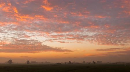 Timelapse of the sunrise in Streefkerk with mills, flat meadows and countryside in the Netherlands.