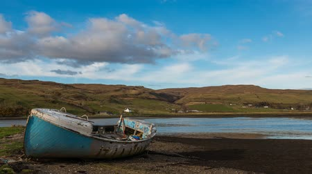 Time lapse or rising tides with old fishing boat on the Isle of Skye in the Scottish Highlands.